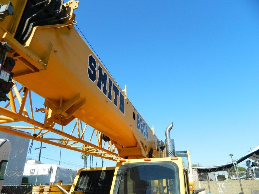 Crane arm with Smith Bros logo
