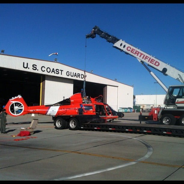 Coast Guard helicopter and certified crane