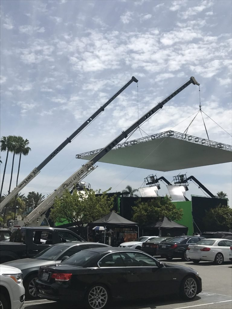 lighting booms and cranes on set