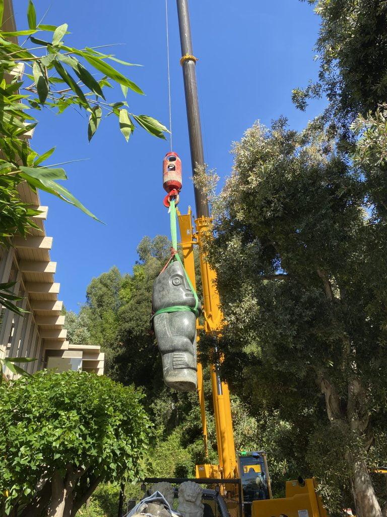 moving a giant tiki by crane