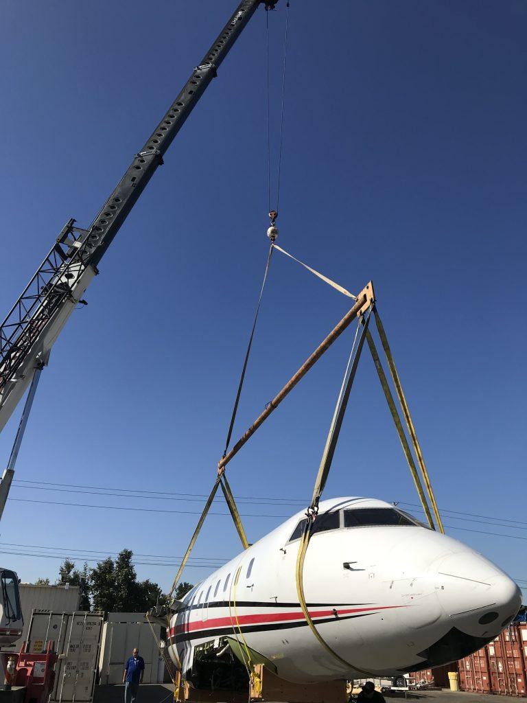 crane lifting a plane