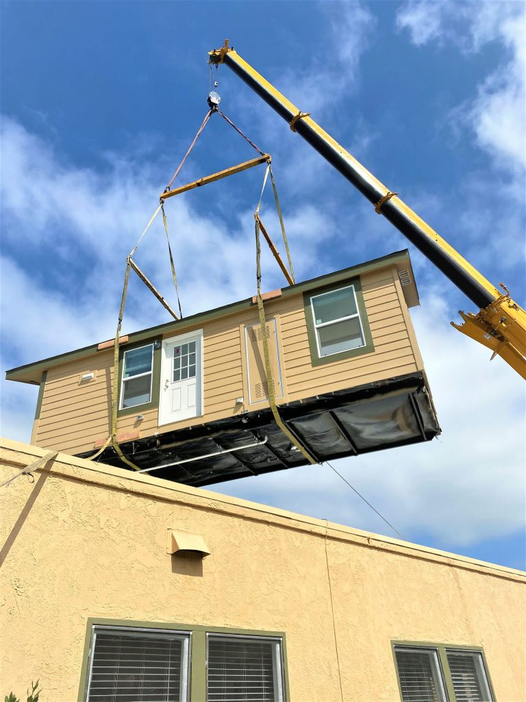 moving houses with a crane