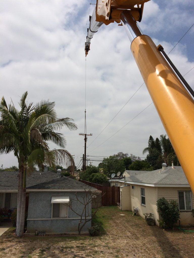 power pole installation via crane